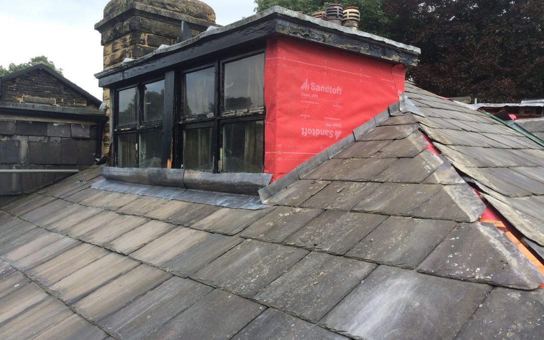 Slating works to roof of Victorian House